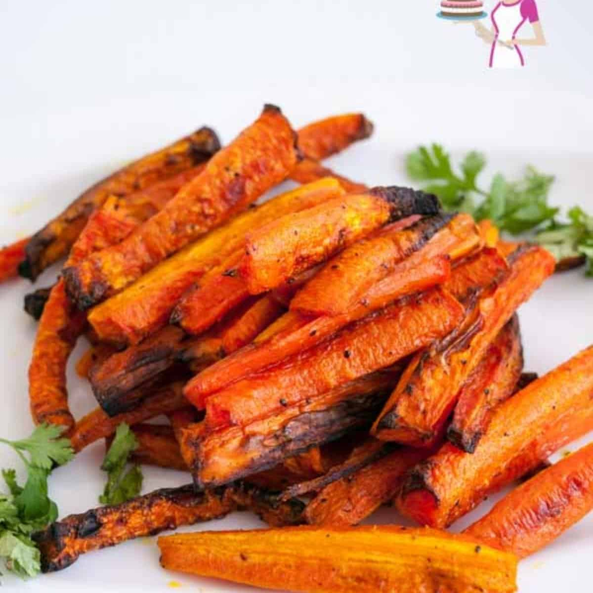 Baked carrots on a white plate