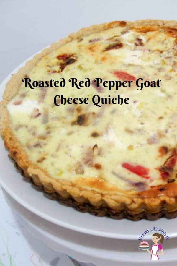 A close up of a roasted red peppers and cheese quiche.