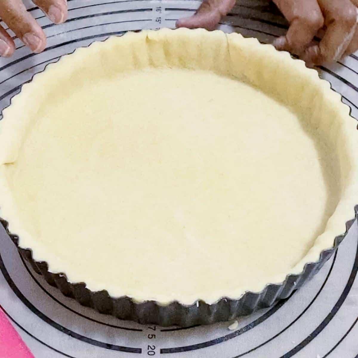 A tart pan with crust.