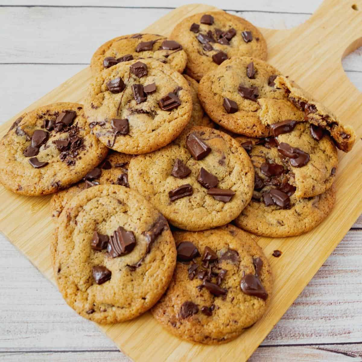 A wooden board with chocolate cookies.