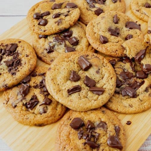 Chocolate chip cookies on a wooden board.