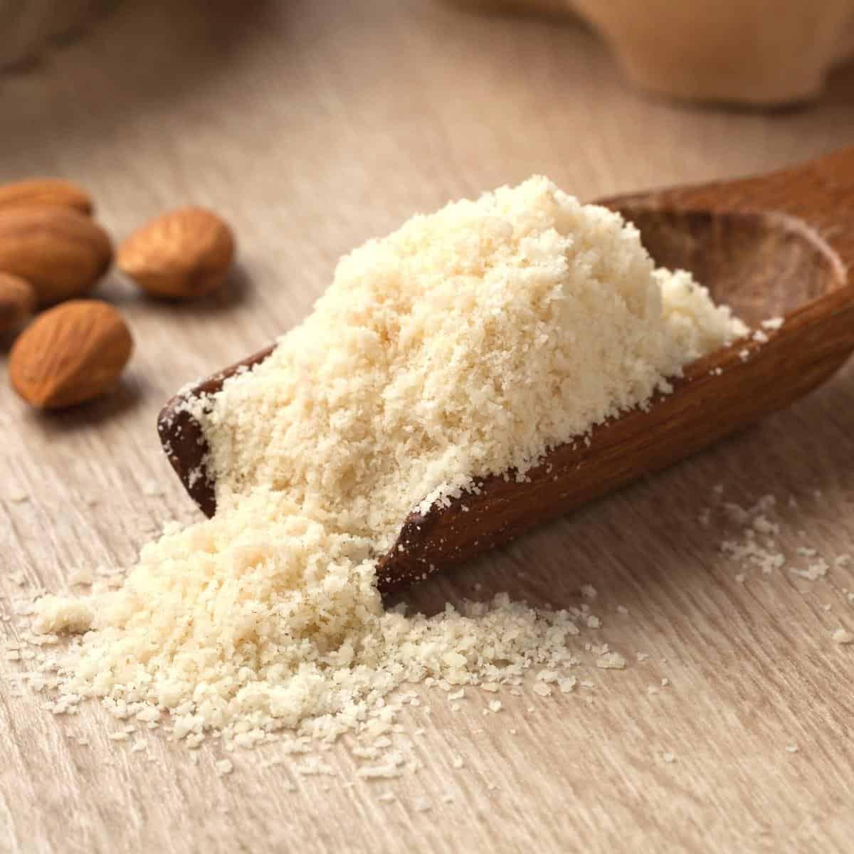 Almond flour in a measuring spoon.
