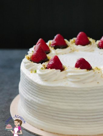 An image optimized for social sharing for this strawberry cream cake with a genoise light sponge cake frosted with whipped cream and fresh strawberries.