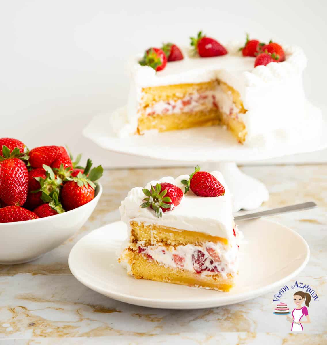 A slice of a Genoise light sponge cake with strawberries and cream.