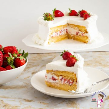 A slice and cake of strawberry cake