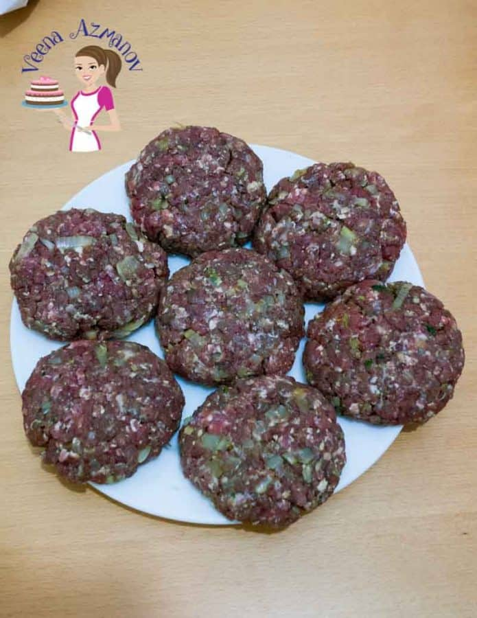 severn burger patties on a plate ready to be grilled