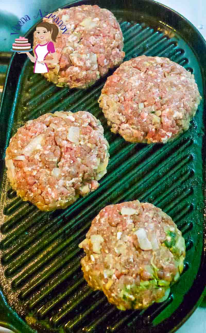 Kebab style Beef Burgers are on the grill.