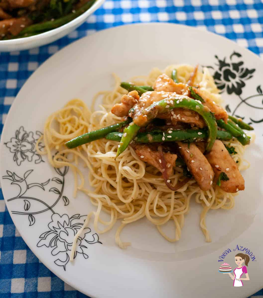 A plate with noodle and stir fry
