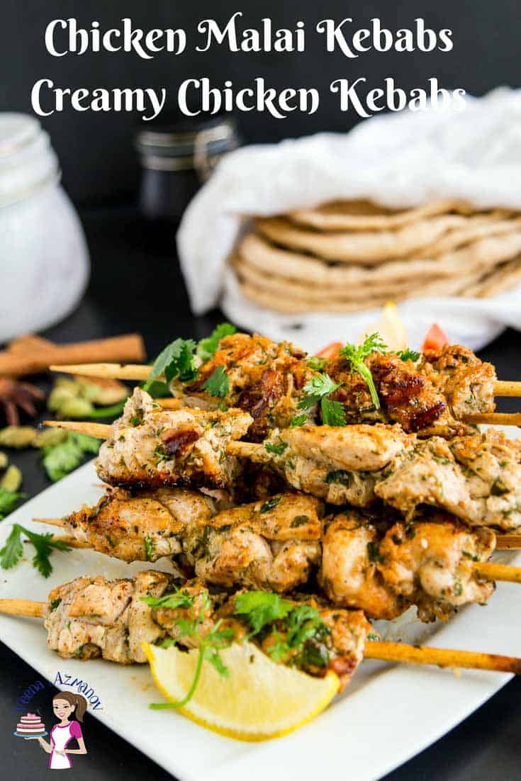 Chicken kebab skewers stacked on a plate.