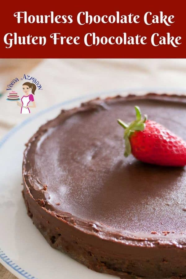 An image optimized for social media sharing for this flourless chocolate cake aka gluten free chocolate cake. Showing the full cake garnished with a strawberry.