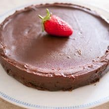 Flourless chocolate cake on a plate.