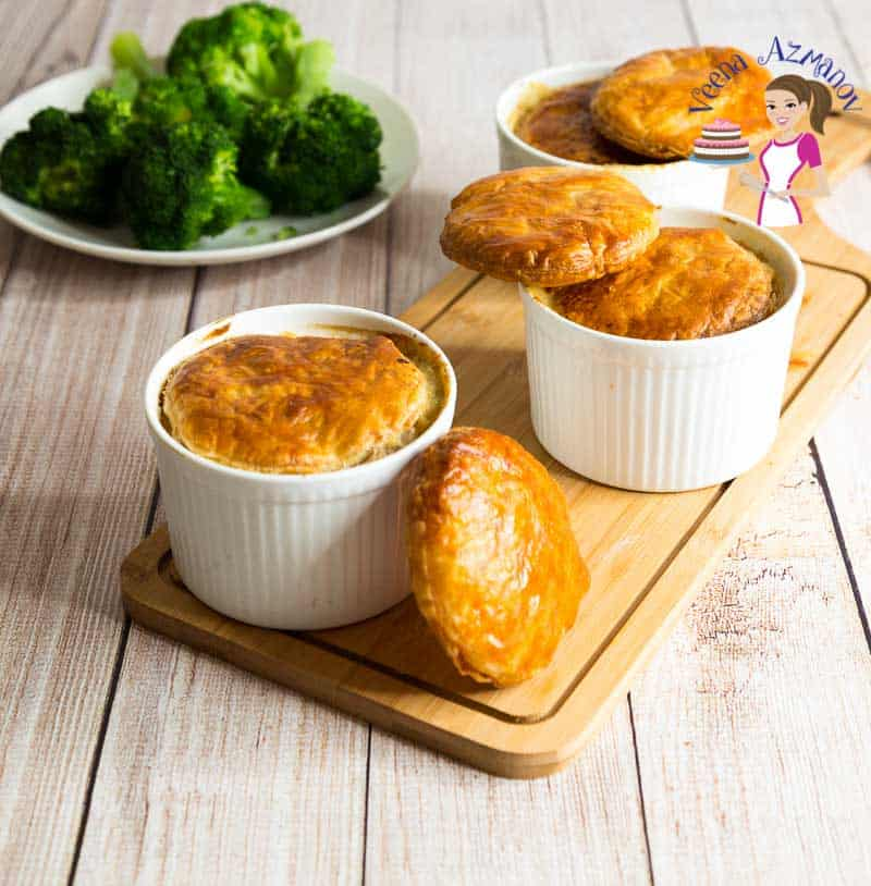 Chicken Pie Soup with carrots, celery, peas and topped with classic puff pastry