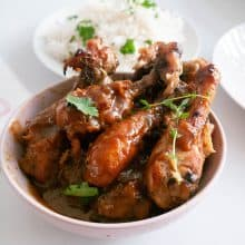 White bowl with baked chicken and rice