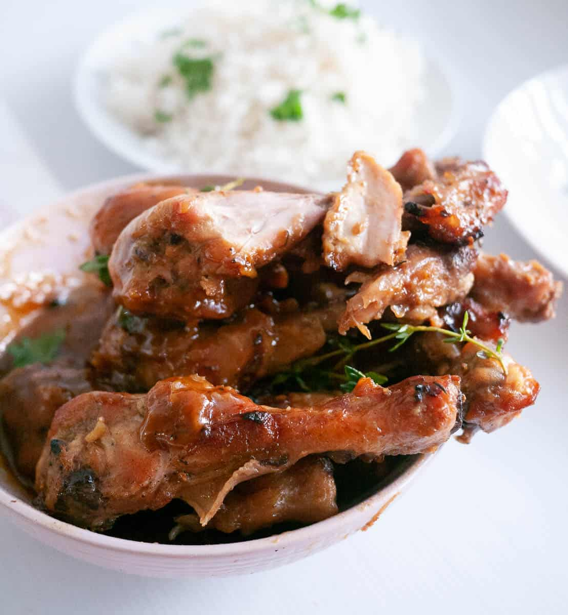 White bowl with baked chicken