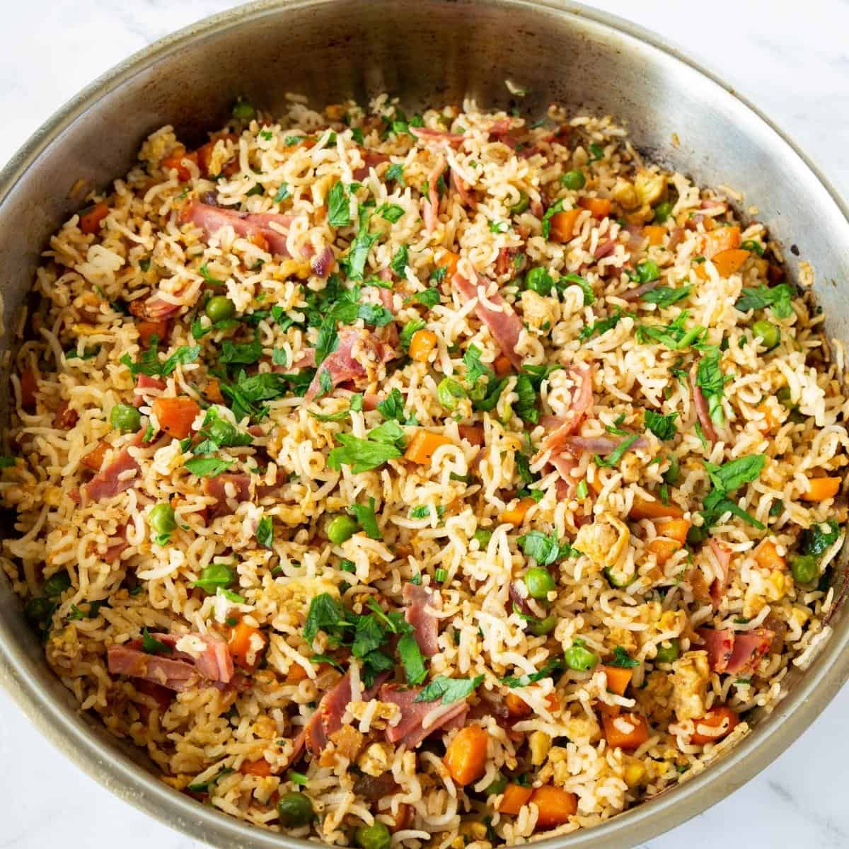 A skillet with fried rice.