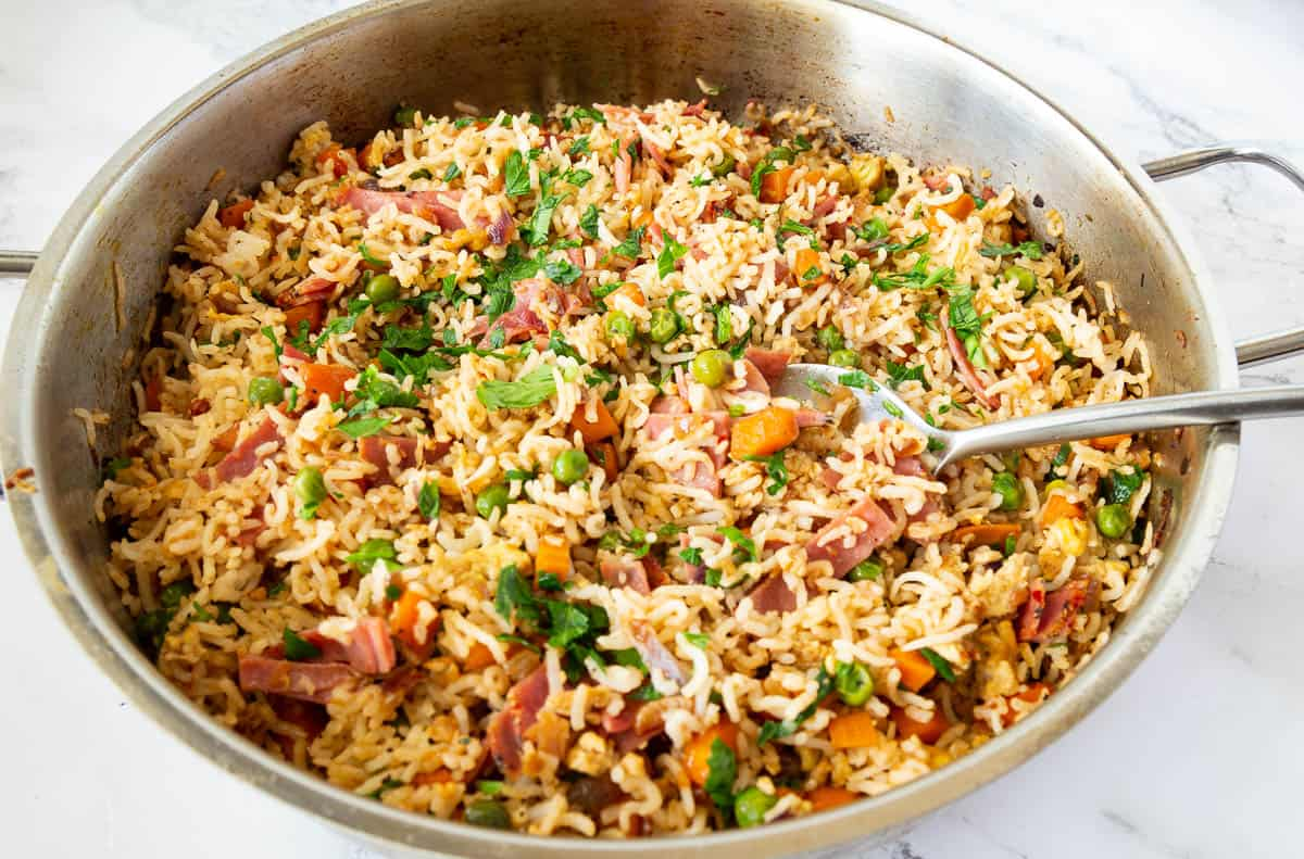A skillet with one pot fried Asian rice.