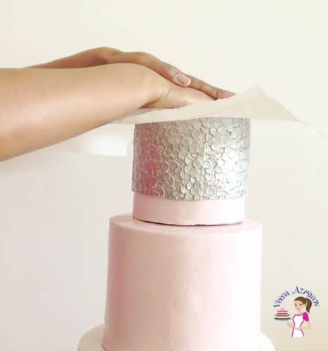 How do you dowel a cake correctly before stacking it