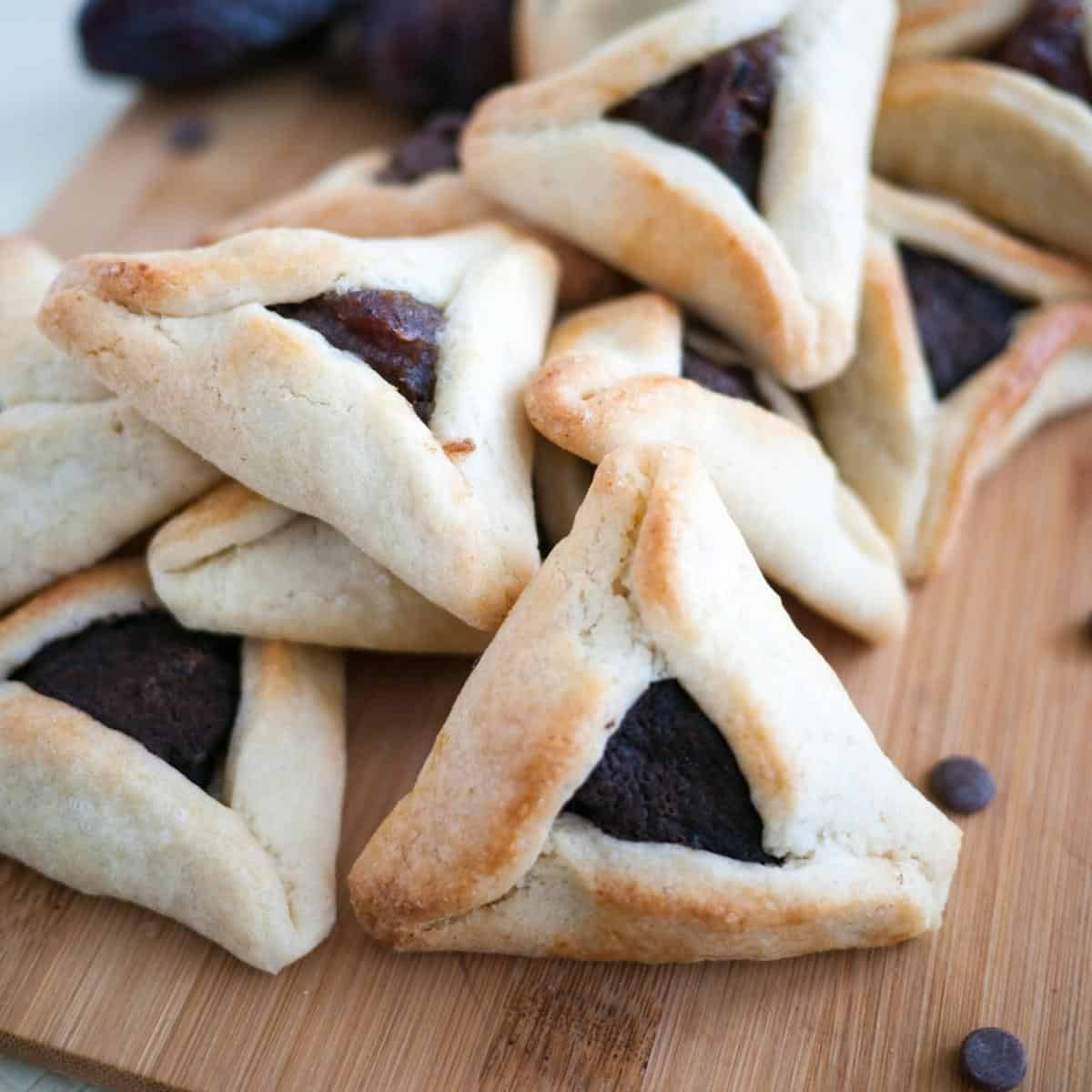 Hamantaschen cookies on a wooden baord