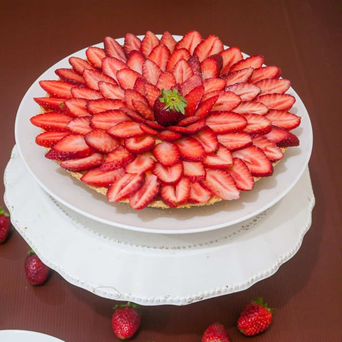 A fruit tart on a cake stand