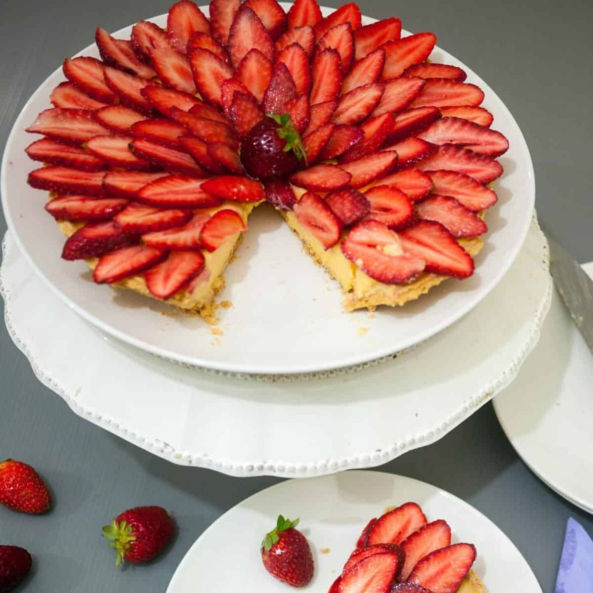 a cut slice of strawberry tart on a plate