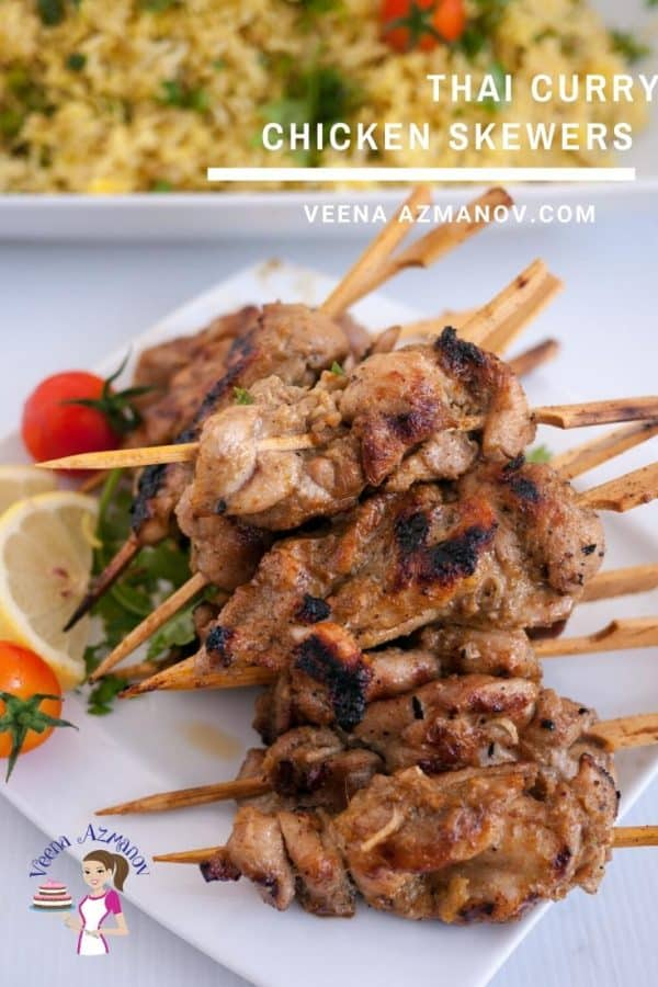 A stack of Thai chicken skewers on a plate.