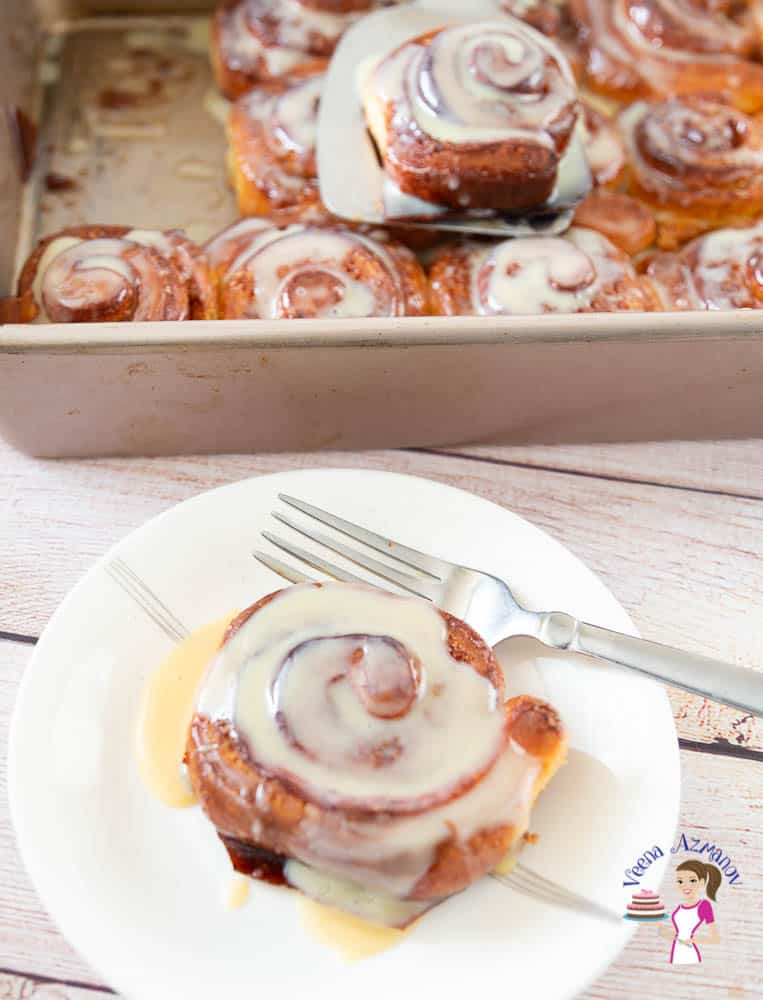 A plate with a cinnamon roll.