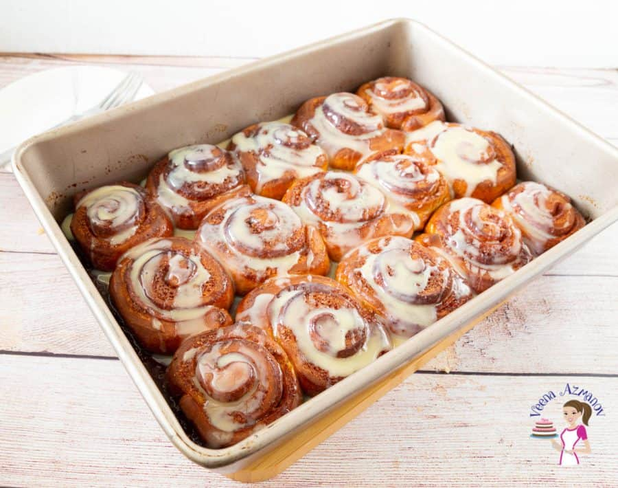 A baking tray with cinnamon rolls.