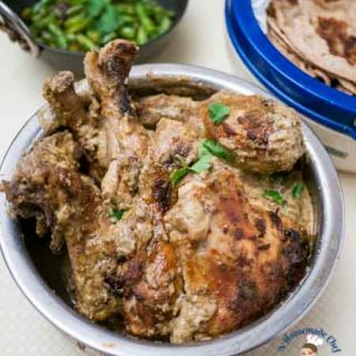 Indian baked chicken in a bowl.