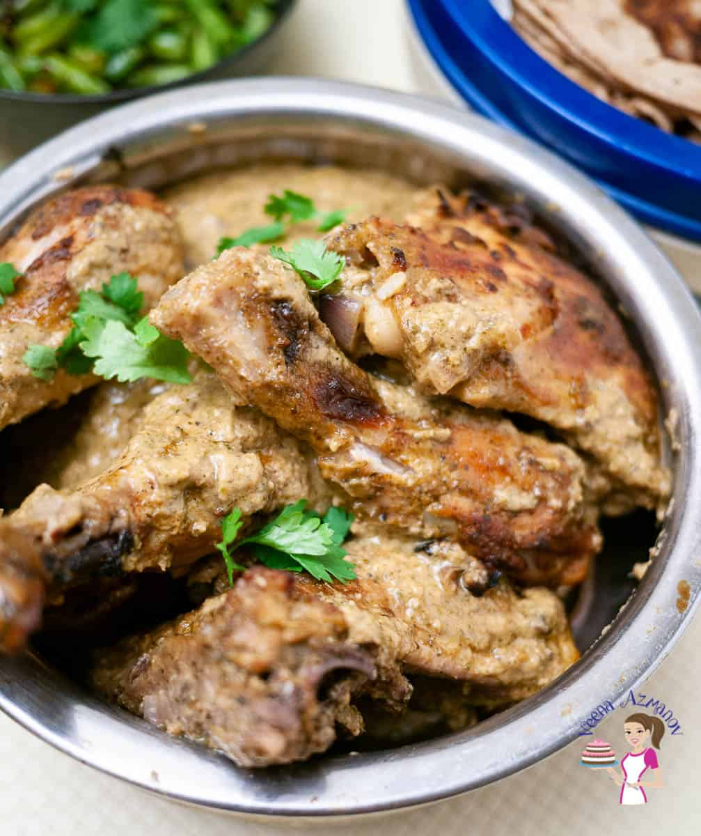 A pot with baked chicken curry