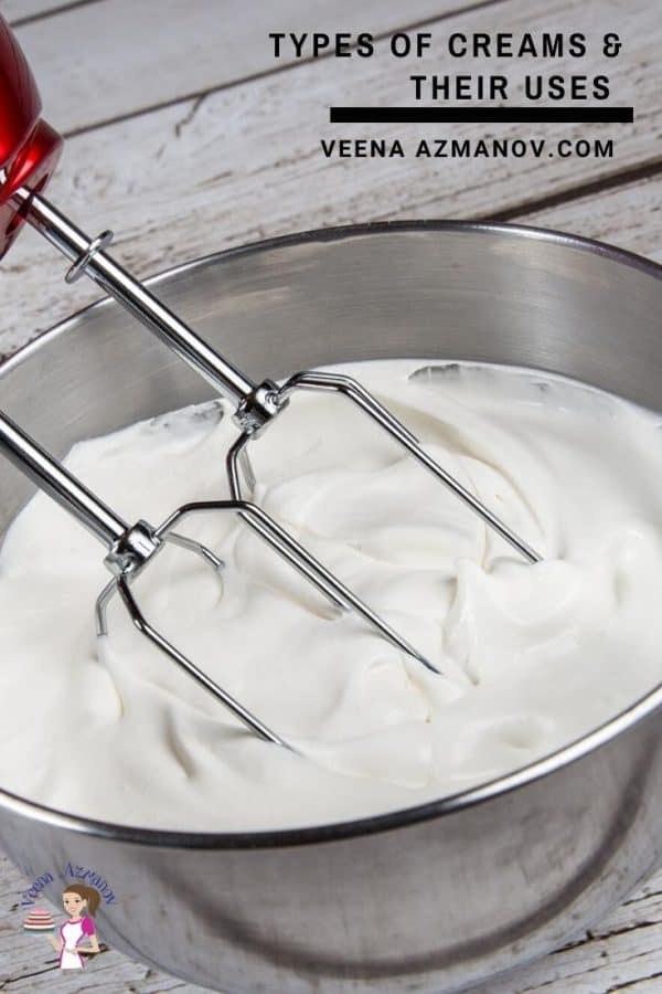 Whipping cream in a stand mixer.