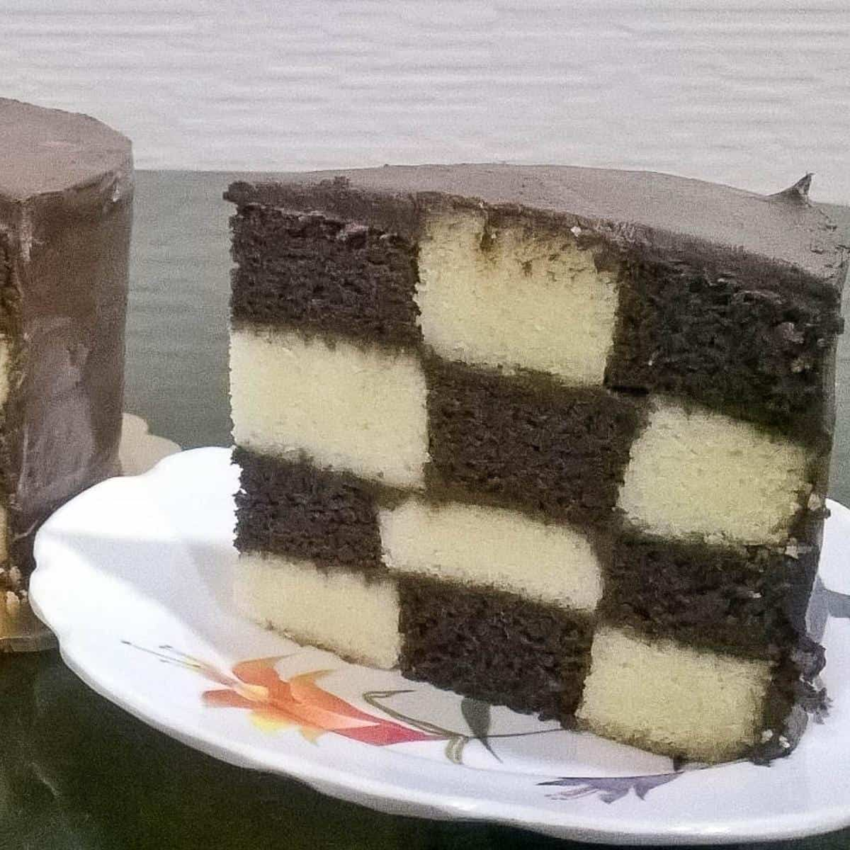 A checkerboard cake slice on a plate