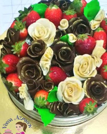 A bowl with chocolates roses and fresh strawberries.