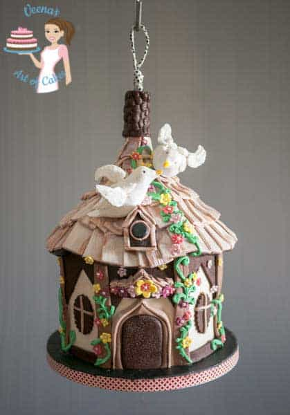 A cake decorated to look like a birdhouse.
