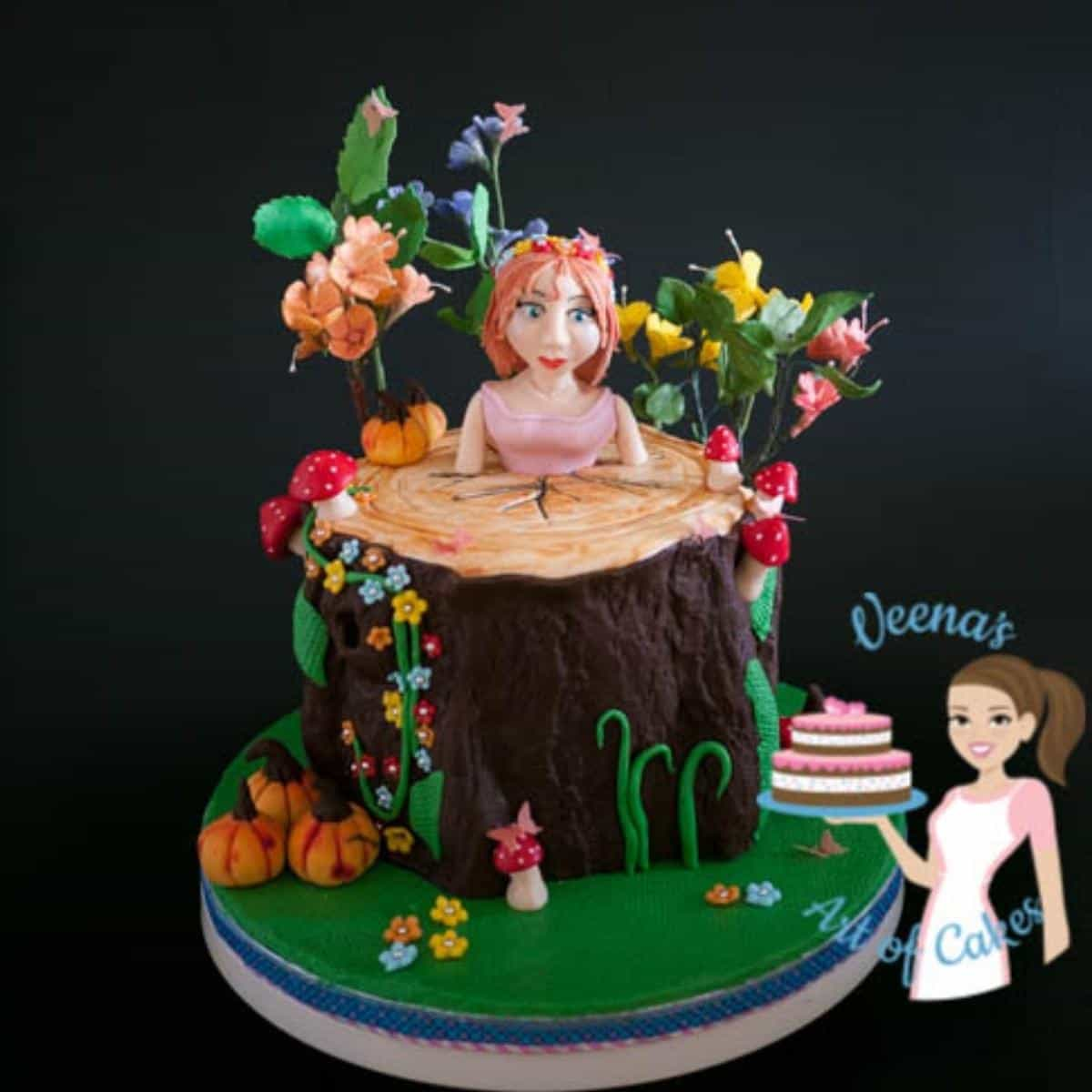 Enchanted forest cake with a girl made from modeling chocolate.