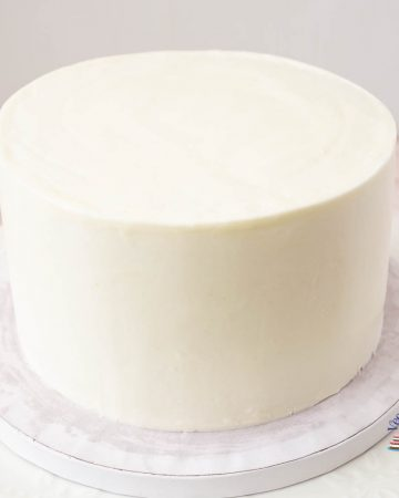A frosted cake with sharp edges.