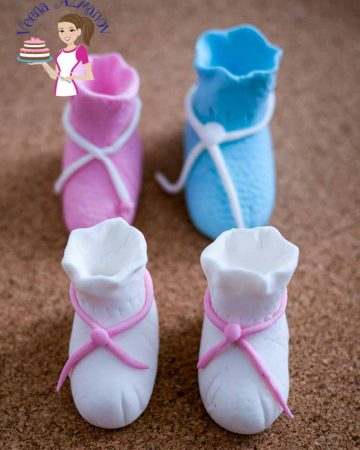 Baby booties made from sugar paste.