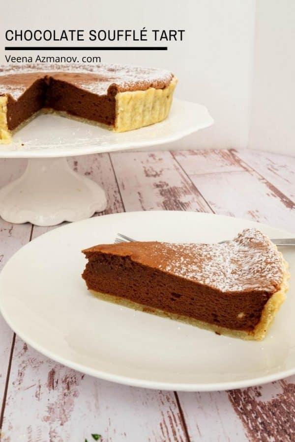 A piece of chocolate soufflé tart on a plate.