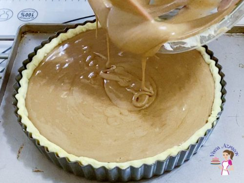Pour the chocolate Souffle into the tart