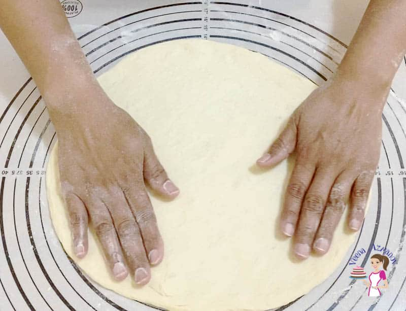 Roll the pizza dough with your finger until you have 12 inches