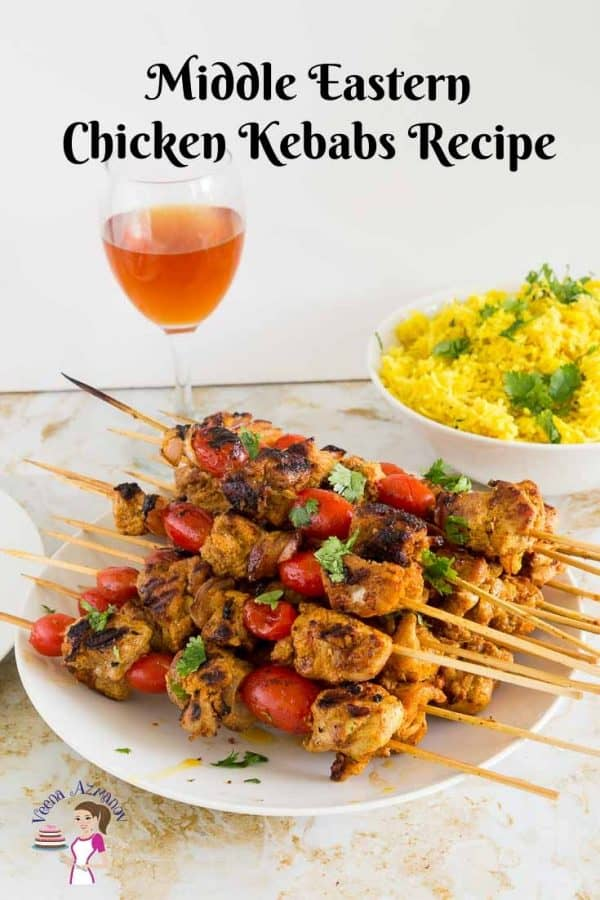 A platter of Chicken on skewers or kebabs served with Turmeric rice and a glass of homemade wine.