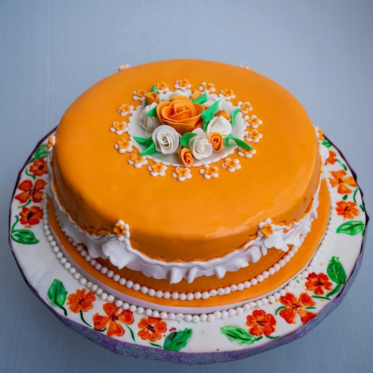 A cake covered with marzipan and fondant.