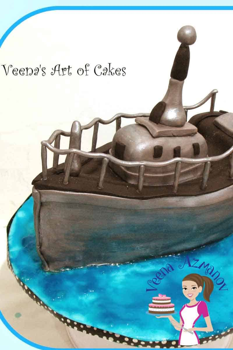 A cake decorated like a navy boat.