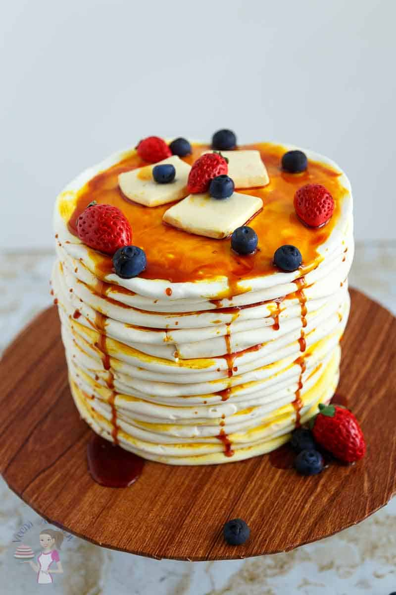 A Pancake cake showcasing the realistic blueberries shown in this video tutorial. Learn how to make sugar paste blueberry
