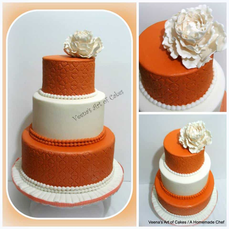 Rust and white Wedding cake topped with a Peony.