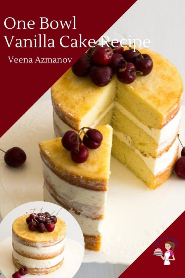 A sliced vanilla layer cake with cherries on top.