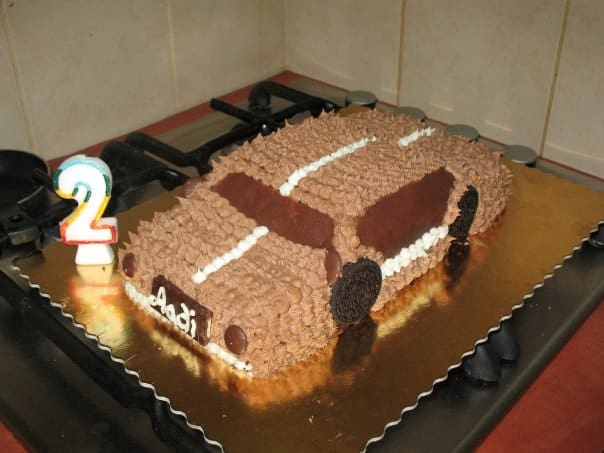 A cake decorated to look like a car.