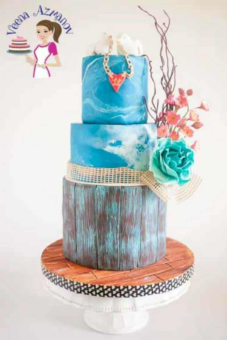 A cake decorated with a marble design fondant.