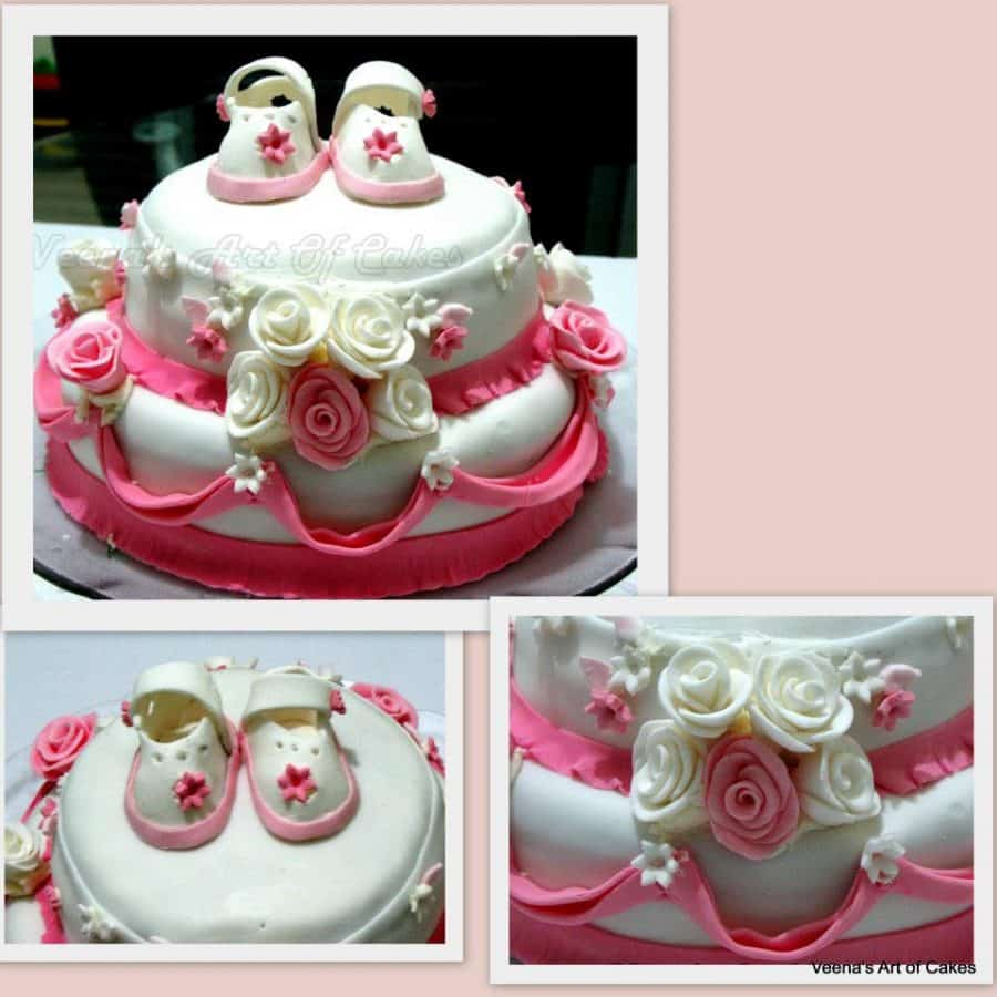 A cake decorated with baby booties made of gum paste.