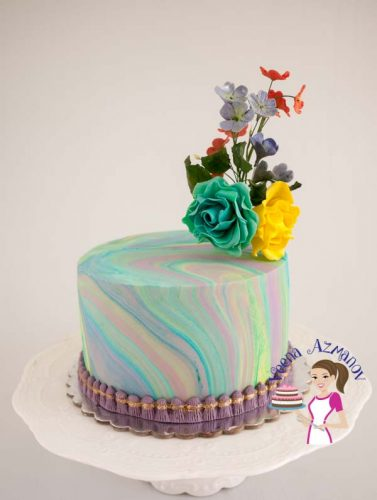 Turqoise Marble fondant cake. How to marble fondant - frost side of the cake showing marbled effect.