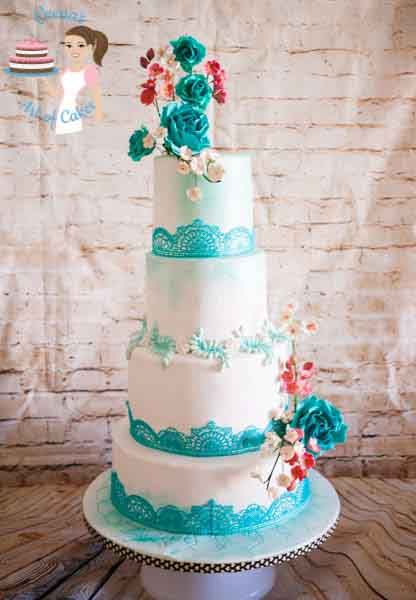 A turquoise lace wedding cake.